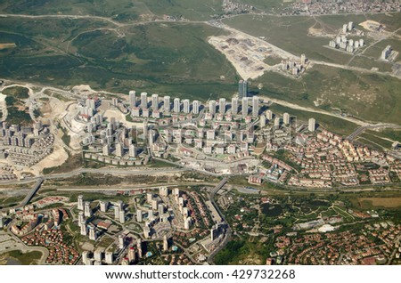 Aerial view of some new high rise housing developments on the Western outskirts of Istanbul.  The  area includes a number of tower blocks of apartments.  - stock photo
