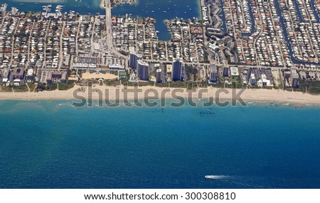 Aerial view of South Singer Island with the Ocean Mall and public beach of Riviera Beach, Florida. - stock photo