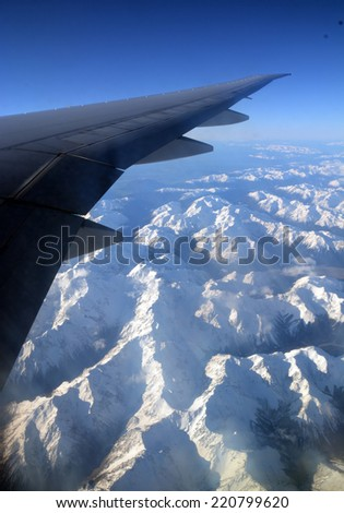 Aerial View of Southern Alps of New Zealand traveling West from Christchurch to Australia in Spring.