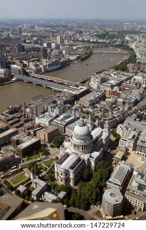 aerial view of St Paul's Cathedral in London with The Thames - stock photo