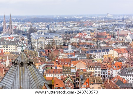 Aerial view of Strasbourg to the old city with red roof tiles. France. Strasbourg is the capital and principal city of Alsace region in eastern France and is official seat of European Parliament.
