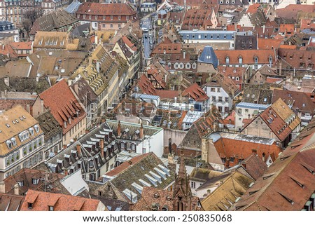 Aerial view of Strasbourg to the old city with red roof tiles. France. Strasbourg is the capital and principal city of Alsace region in eastern France and is official seat of European Parliament. - stock photo