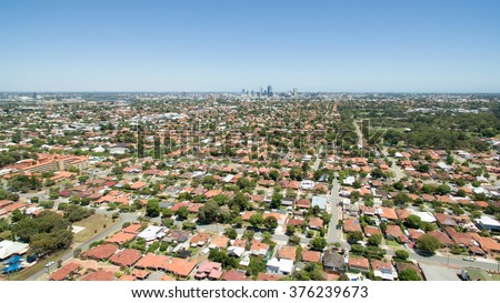 Aerial view of suburbs surrounding Perth WA, with Perth in the background.