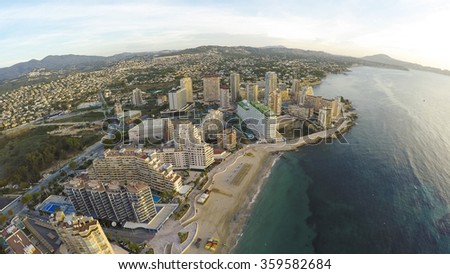Aerial view of sunny morning on the beach of Calpe, Calp. Penon de Ifach also on the photo. Amazing VIDEO from that scene / location also available in UHD 4K! You can't miss it! - stock photo