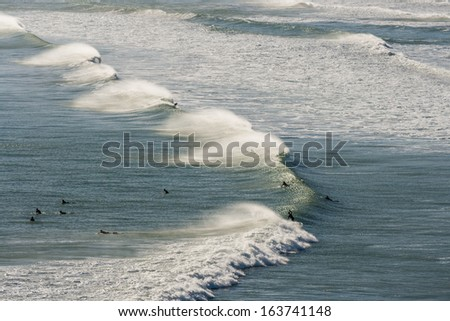 aerial view of surfers waiting for wave - stock photo