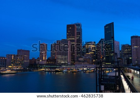 Aerial view of Sydney Central Business District skyscrapers on dusk. Urban landscape view from above. Circular Quay, Australia