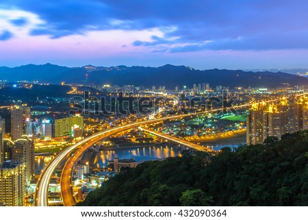 Aerial view of taipei at night with highway - stock photo