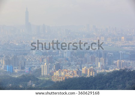 "Aerial view of Taipei, capital city of Taiwan, with heavily polluted air on a hazy winter day ~  Air pollution level classified as ""Beyond Index"" (PM 2.5 over 500 micrograms per cubic meter)"