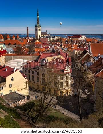 Aerial View of Tallinn Old Town and Olaviste Church from Toompea Hill, Tallinn, Estonia - stock photo