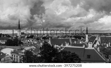 Aerial view of Tallinn old town, Estonia. Red rooftops with colorful cloudy sky. Popular landmark in Baltic region - stock photo