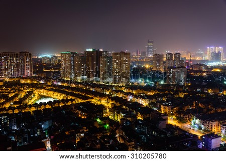 Aerial view of Thanh Xuan district, Hanoi, Vietnam at night with dense of town house, skylines and apartment buildings. Hanoi is capital of Vietnam, It's an energetic city on the move