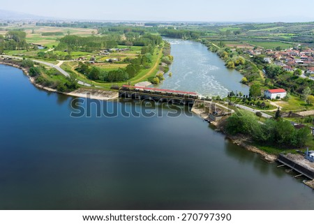 Aerial view of the artificial lake Kerkini and river Strymon with dam at the north Greece - stock photo