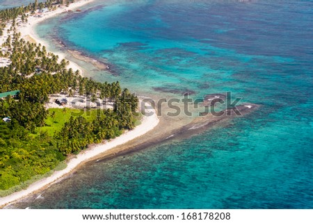 aerial view of the barrier reef of the coast of San Pedro, Belize. with small land masses or cayes - stock photo