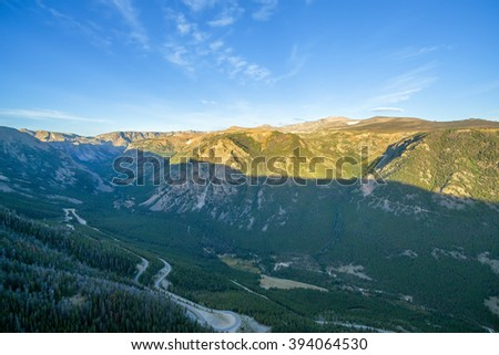 Aerial view of the Beartooth Mountains with a switchback road visible below - stock photo