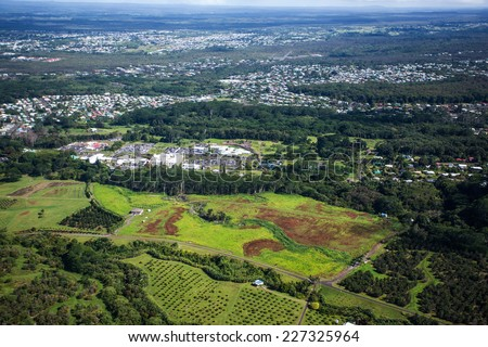 Aerial view of the Big Island of Hawaii, over Hilo, the capital city of Big Island. - stock photo
