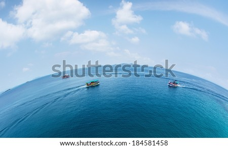 Aerial view of the boats crossing tropical sea at sunny day - stock photo