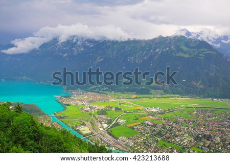 Aerial view of the city district and Interlaken Ost railway station. Switzerland. - stock photo