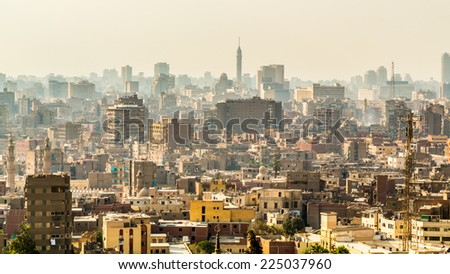 Aerial view of the city of Cairo with densely packed residential homes and buildings - stock photo
