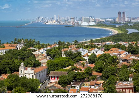 Aerial view of the city of Olinda and Recife in Pernambuco, Brazil showcasing its mix of historic and modern architecture on a sunny and very hot day. - stock photo