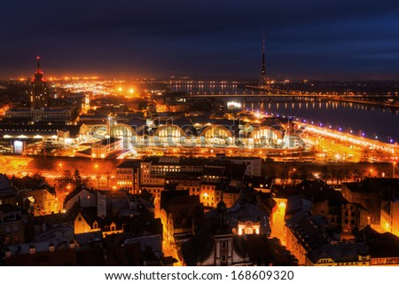 aerial view of the city of Riga in Latvia with the river Daugava at night