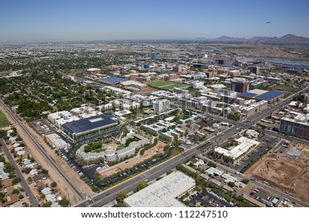 Aerial view of the City of Tempe with college campus skyline - stock photo