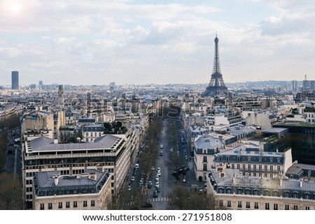 Aerial view of the city with blue cloudy sky and Eiffel Tower from the Arc de Triomphe, Paris. - stock photo