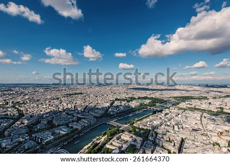 Aerial view of the city with blue cloudy sky from the Eiffel Tower, Paris. - stock photo