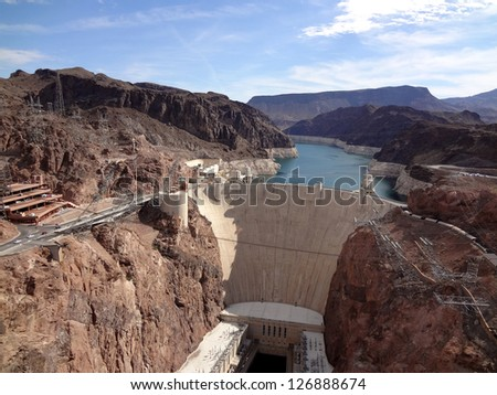 Aerial view of the Colorado River and Hoover Dam, a snapshot taken from bypass bridge on the border of Arizona and Nevada, USA - stock photo