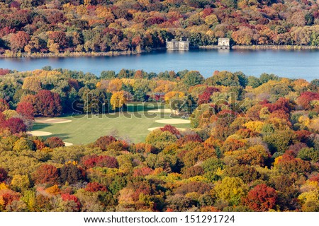 Aerial view of the Great Lawn and Jacqueline Kennedy Onassis Reservoir in Central Park, New York City. Show of autumn foliage around the baseball and softball fields. - stock photo