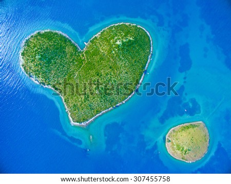 Aerial view of the heart shaped Galesnjak island on the adriatic coast of Croatia. - stock photo