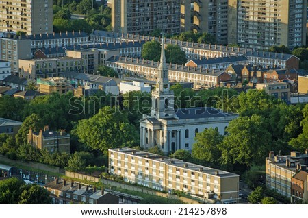 Aerial view of the historic All Saints Church in Poplar, Tower Hamlets.  The church was built mostly in Georgian times and was badly damaged during the WWII Blitz. - stock photo