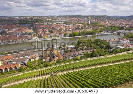 Aerial view of the historic city of Wuerzburg, region of Franconia, Northern Bavaria, Germany. The town is located on the Main River.  In foreground are seen the old vineyards. - stock photo