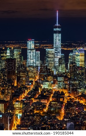 Aerial view of the Lower Manhattan skyscrapers by night - stock photo