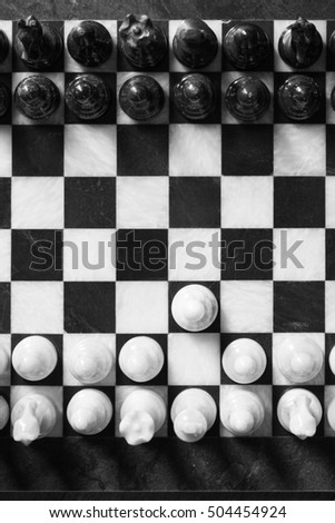Aerial view of the marble chessboard. Concept of confrontation, competition. One step forward for competition.