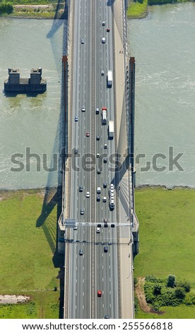 Aerial view of the Martinus Nijhoff bridge with highway A2 near the town of  Zaltbommel in the province of Gelderland, the Netherlands. - stock photo