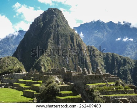 Aerial view of the most famous landmark of Cuzco in Peru, the ancient inca city of Machu Picchu. - stock photo