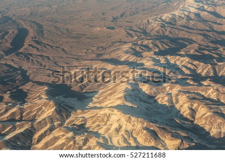 Aerial view of the mountain high snow-capped peaks