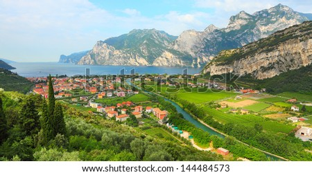 Aerial view of the Nago - Torbole situated in the northern part of The Lake Garda (Lago di Garda or Lago Benaco). Italian largest lake is located in Northern Italy.