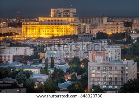 Aerial view of the Parliament building in Bucharest, Romania at nigh time.