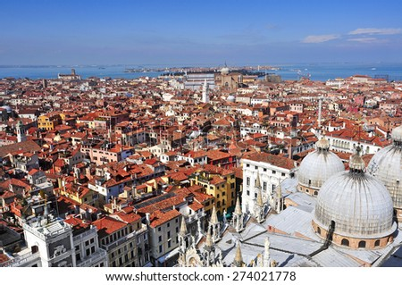 aerial view of the Patriarchal Cathedral Basilica of Saint Mark and the roofs of Venice, Italy