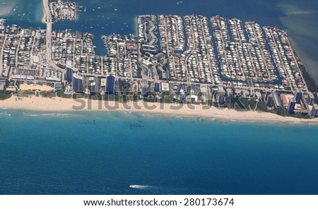 Aerial view of the Singer Island community with the Ocean Mall, beach access and hotels and condos on the beach - stock photo