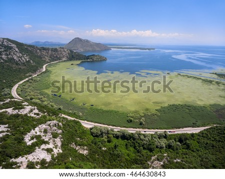 Aerial view of the Skadar lake with highway around. Skadarsko jezero is a national park in Montenegro
