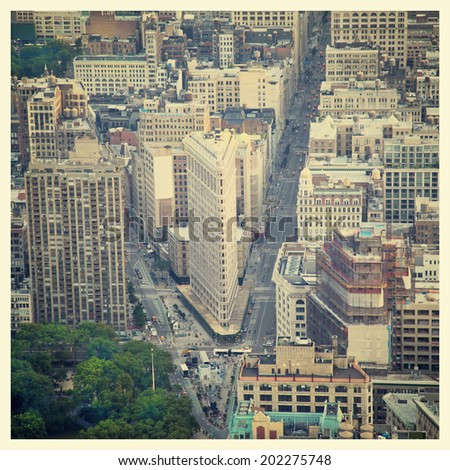 Aerial view of the streets of New York City including the Flatiron building with instagram style filter - stock photo