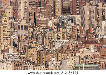 Aerial view of the super crowded, populated, and busy New York city in the USA showcasing the sea of historic and ancient buildings that characterize its world wide known architecture.  - stock photo