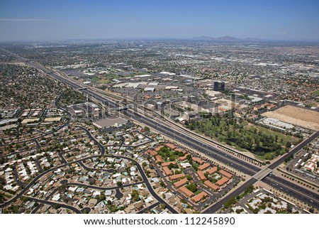 Aerial view of the Superstition Freeway in Mesa looking Northwest towards Tempe and Phoenix, Arizona - stock photo