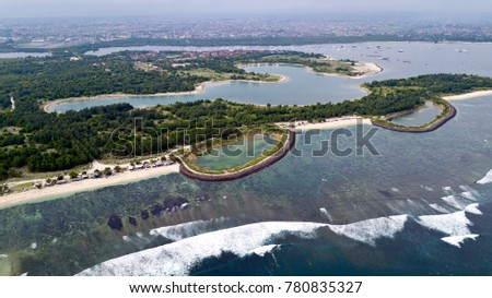 Aerial view of the surf spot at Serangan beach and the surrounding area.