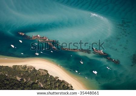 Aerial view of the Tangalooma Wrecks at Moreton Island, Queensland, Australia - stock photo
