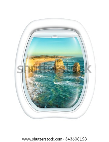 Aerial view of the Twelve Apostles in Port Campbell National Park, on the Great Ocean Road, Victoria state, Australia on board of a plane through the porthole window. Copy space. - stock photo