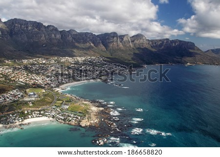 Aerial view of the Twelve Apostles, part of the Table Mountain, and Camps Bay, a suburb of Cape Town. - stock photo