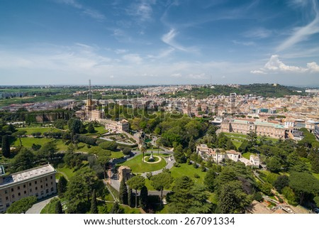 Aerial view of the Vatican City and Rome, Italy. Gardens, Convent, Vatican Radio, Memorial, Casina Pio IV. Panorama of the old historical center. View from the roof of Saint Peter Basilica. - stock photo